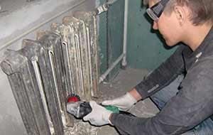 Демонтаж батарей отопления