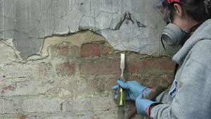 Демонтаж фасадной штукатурки
